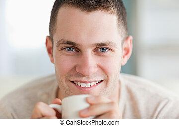 Close up of a man having a tea