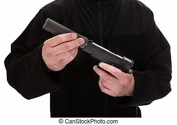 Close-up Of A Man Holding Handgun