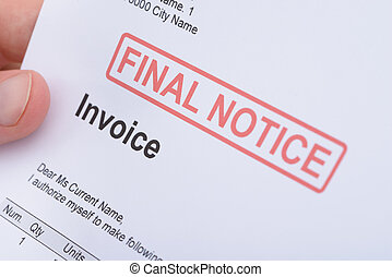 Man Holding Invoice With Final Notice Stamp