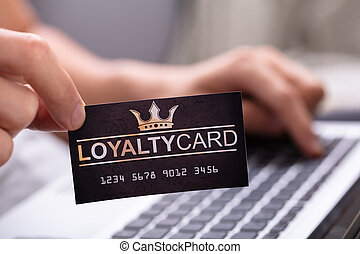 Close-up Of A Man Holding Loyalty Card