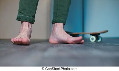 Close-up of a man legs standing on the floor of a room