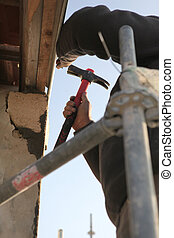Close-up of a man on scaffolding