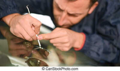 Close-up of a man professionally in the workshop engaged in...