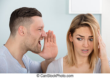 Man Screaming In His Wife's Ear