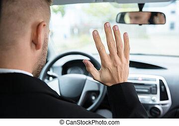 Man Sitting On Self Drive Car Seat