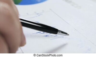 Close up of a man studying a graph