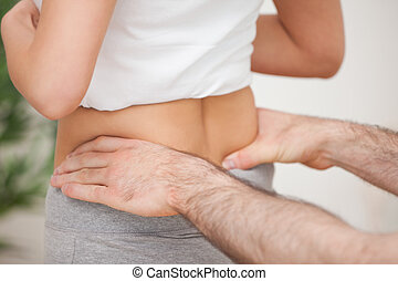 Close-up of a man touching the hips of a woman in a room