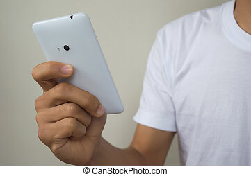 Close up of a man using mobile phone