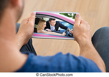 Man Watching Video On Cellphone - Close-up Of A Man Watching...