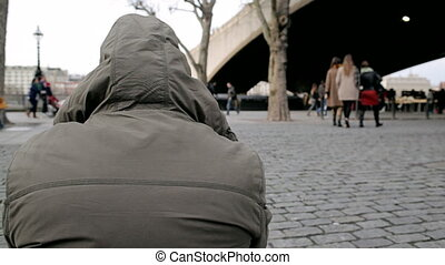 Close-up of a man with a hoodie - LONDON - Close-up of a man...