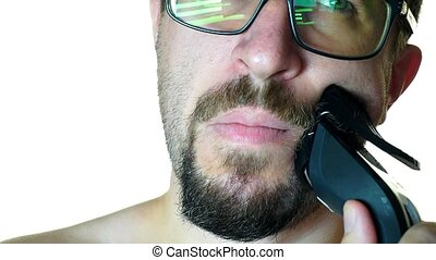Close-up of a man with glasses shaves off his beard. on a white background