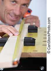 close-up of a man with tape measure