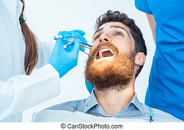 Close-up of a man with the mouth open during a medical procedure