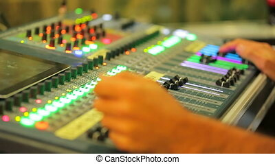 Close Up of A Man Working on Mixing Control Panel