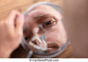 Man's Face In Broken Mirror - Close-up Of A Man's Face In...