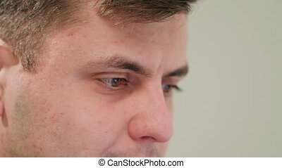 Close-up of a Man's Face Indoors