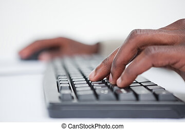 Close up of a masculine hand using a keyboard