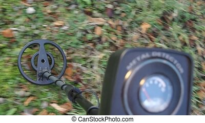 metal detector - close up of a metal detector moving to the...