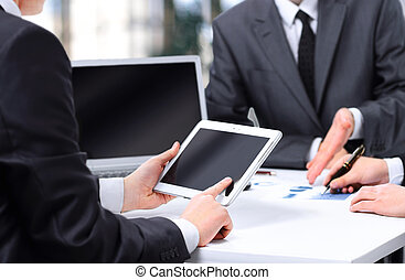 business team using tablet