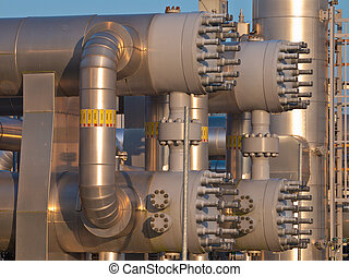 close up of a modern natural gas processing plant during sunset
