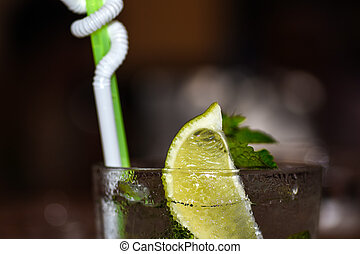 Close-up of a mojito cocktail is on the table in a day cafe