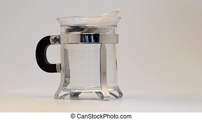 Close up of a mug in glass with dark black coffee
