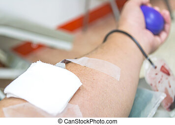 Close up of a patient transfused blood in hospital