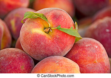 peach with leaf - Close up of a peach with leaf at the ...