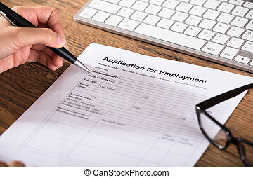Person Filling The Employment Application Form