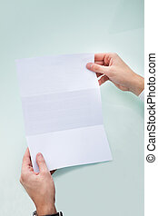 Person's Hand Holding Blank Paper