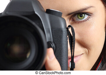 Close up of a photographer photographing with a dslr camera