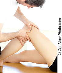 Close-up of a physical therapist giving a leg massage
