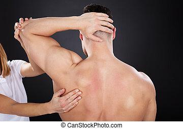 Physiotherapist Giving Shoulder Massage