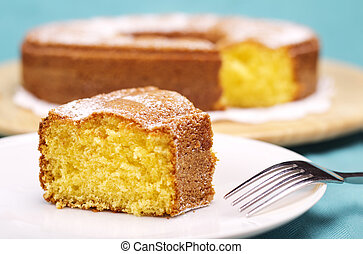 close up of a piece of cake with icing sugar