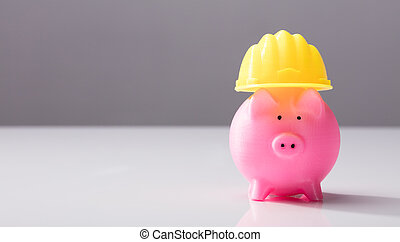 Close-up Of A Piggy Bank With Hard Hat