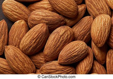 Close up of a pile of almonds as background.