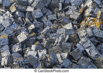 Close up of a pile of crushed cars