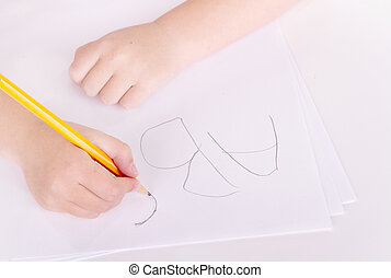 preschooler learning to write alphabet - Close-up of a ...