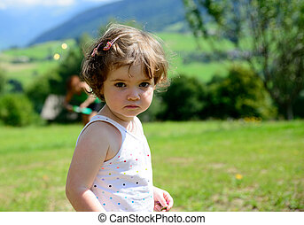 close up of a pretty little girl in the garden