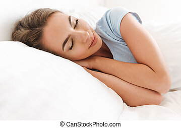 Close up of a pretty young woman sleeping