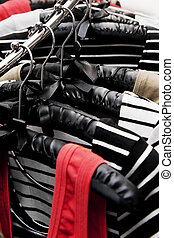 close up of a rack of women's clothes in a boutique