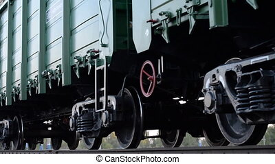 Close-up of a railway crossing, sign, freight train