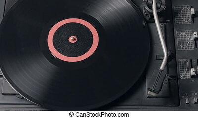 Close up of a record player playing vinyl. Retro Vinyl...