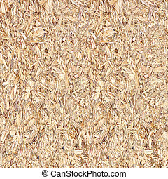 Close up of a recycled compressed wood chippings board