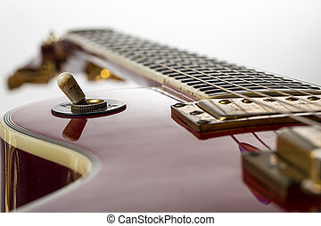 close up of a red electric guitar