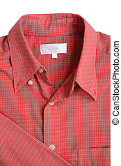 Close up of a red mens shirts isolated on white