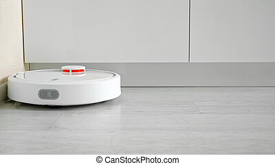 Close-up of a robot vacuum cleaner driving on the floor