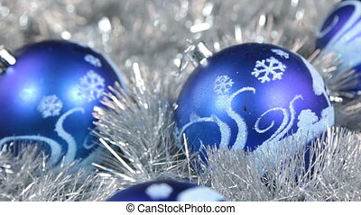 Close-up of a rotation four of blue Christmas balls....
