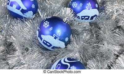 Close-up of a rotation of blue Christmas balls. Christmas...