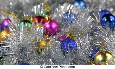 Close-up of a rotation of multi-colored Christmas balls....